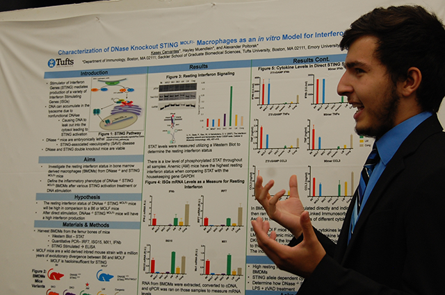 student presenting at the poster fair