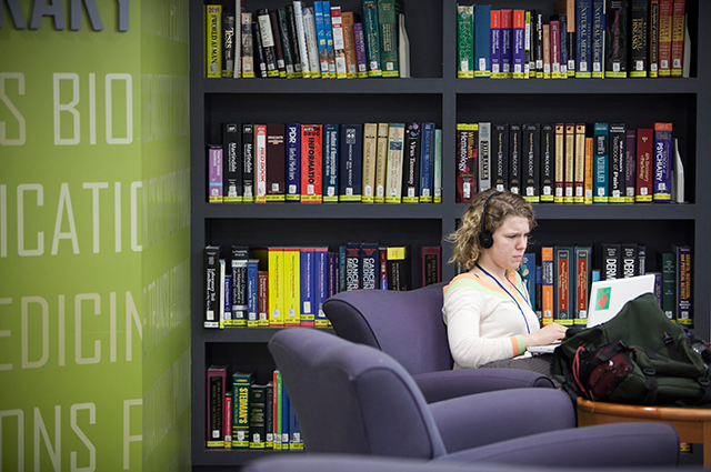 Student in the Hirsh Library