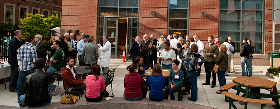 Students and faculty at a reception
