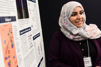 Student presenting at a poster fair